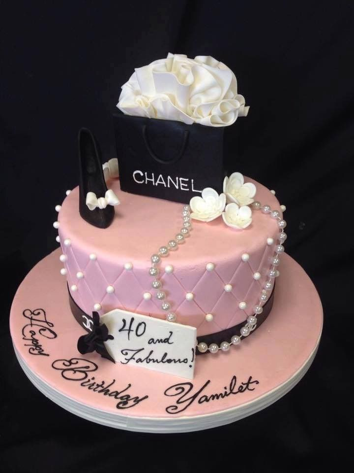 Pink Chanel cake , Chanel black bag cake top layer