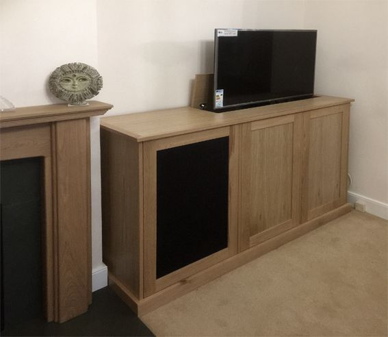 tv cabinet with lift and swivel storage for av equipment with infra red friendly speaker