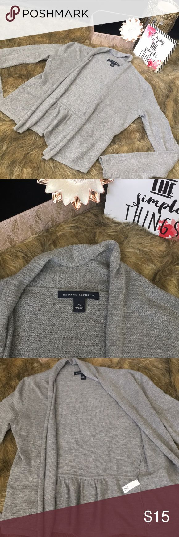Light Gray Petite Cardigan💕 Really cute lightweight cardigan perfect for those petite ladies that hate feeling like they are drowning in everything! Size XS and fits true to that. No signs of wear this is perfect condition no rips, stains, or smells. Made of 85% Pima Cotton 14% Merino Wool Banana Republic Sweaters Cardigans