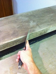 Covering laminate countertops with a layer of concrete… Inexpensive upgrade, if it works.