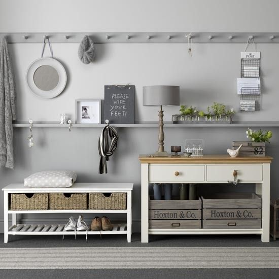 Cool, calming grey with the use of console tables and basket storage Housetohome.co.uk
