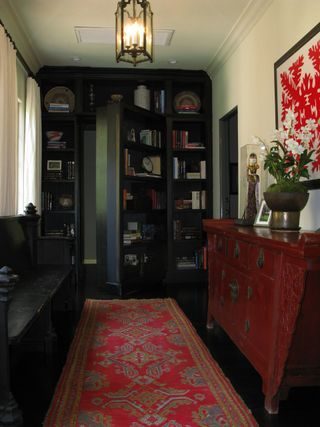 standard hallway with a secret passage way. bookcase with