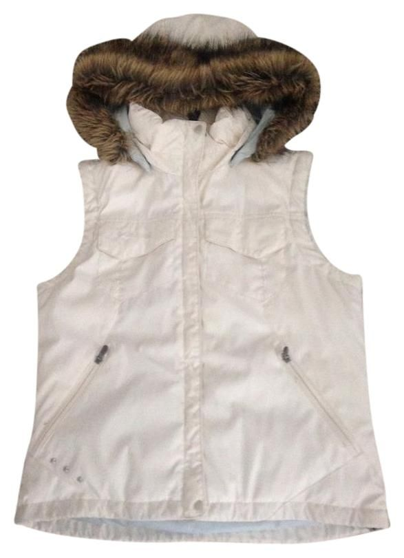 Columbia Sportswear Company Down Vest. Free shipping and guaranteed authenticity on Columbia Sportswear Company Down VestWhite down vest with fur lined hood, fur can be re...
