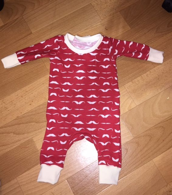 Newborn Jumpsuit. Opens at back.