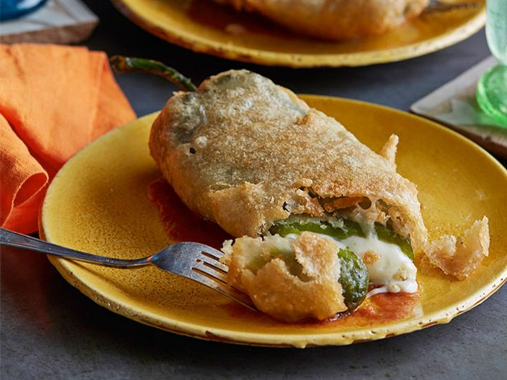 Chiles Rellenos : Stuff poblano chiles with Oaxacan-style string cheese before dredging and frying until golden brown.