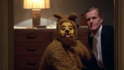 Why That Bear Performed Fellatio on That Guy in 'The Shining' http://filmanons.besaba.com/why-that-bear-performed-fellatio-on-that-guy-in-the-shining/    Kubrick's biggest WTF moment is finally explained.        There's plenty of speculation surrounding hidden meanings and conspiracy theories of The Shining (a feature-length documentary's worth, to be exact) but the strangest part of the film may forever be Wendy's sudden discovery of a man in a work suit receiving fellatio from a […]