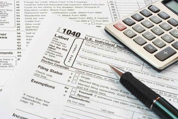 Tricare users will need to identify themselves and their families on their 2014 tax forms as having healthcare coverage, Defense Department officials said, or risk paying a fine.