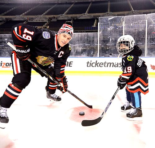 2/28/2014 - 2014 NHL Stadium Series Practice Day - Jonathan Toews with Make A Wish child