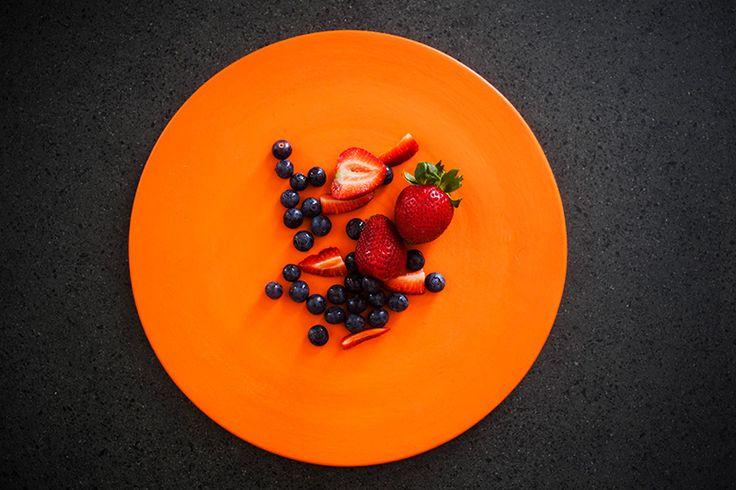 Strawberries & blueberries on Orange