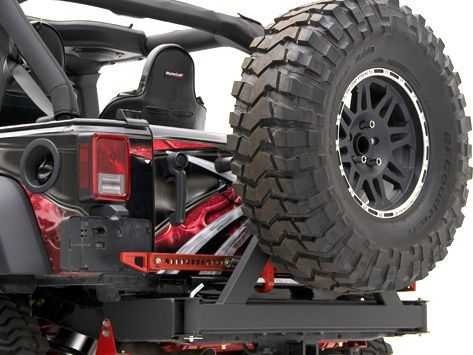Rancho Rear Off-Road Bumper with Tire Carrier. All in one tire carrier and bumper. Nice upgrade for the rear.  Comes with a specific area and the bolts to mount your high jack. It is a shorty bumper as well.