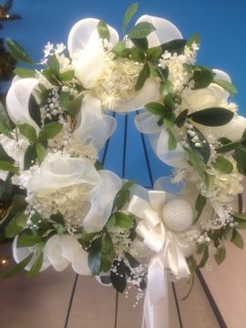 Beautiful Deco mesh wreath accented with pearls,foliage and white satin ribbon . . perfect for a wedding..