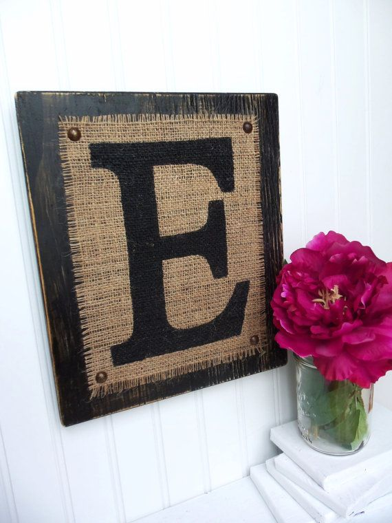 How easy is this? Block painted black, burlap just tacked on with stenciled initial. Simple and very cute!