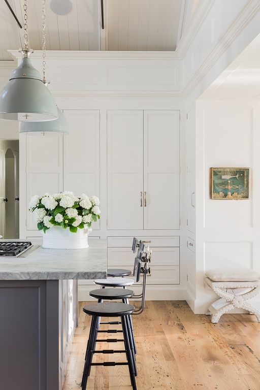 Traditional Kitchen with Hardwood floors, Restoration Hardware - Vintage Toledo Bar Chair, Complex marble counters, One-wall