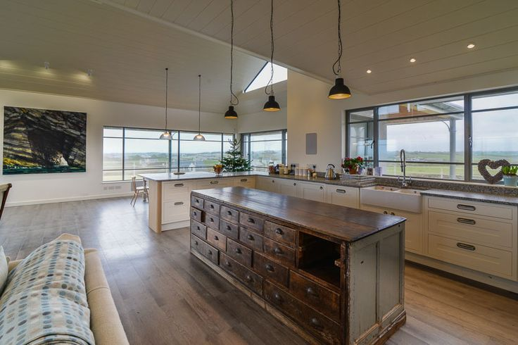 Trenouth - Cornwall -  A Cornish, self catering beach holiday house to rent at Treyarnon Bay, just a short drive from Padstow.  Open plan kitchen living area with reclaimed kitchen storage.  Double Belfast style sink with stylish mixer tap.