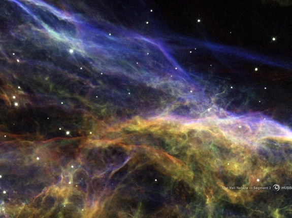 A portion of the Veil Nebula, left behind with the violent explosion of a massive star, shows delicate wisps of gas and dust.