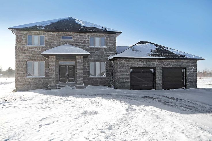 Located in the popular new community of Water's Edge, this custom built home offers a traditional centre hall design. The exterior is finished in stone and has carefully selected, top quality interior finishes with a contemporary flair. Nine foot ceilings throughout the main level. Custom cabinets and top quality flooring throughout.