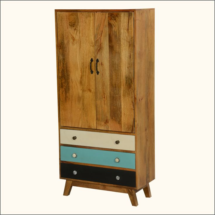 """If you are suffering from lack of closet space, it's time to discover our 60's Mod Standing Wardrobe.  This handmade hardwood cabinet stands off the floor on a platform with slanted legs.  This modified armoire measures 63"""" tall, has three long bottom drawers in three different colors, and a double door 3 shelf top storage section.  This smart wardrobe is built with mango wood, a tropical hardwood grown as a renewable crop. MDF is used in the back."""