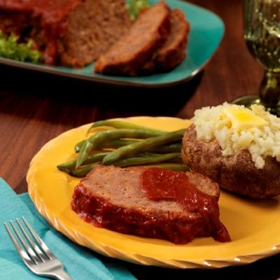 This is  one of my most requested recipes for Meatloaf from covered dish dinners.  Recipe is also on the Hunts Seasoned Tomato  Sauce for Meatloaf can.  So easy to make and this sauce takes all the guess work out of getting the seasonings just right.   Yummy!