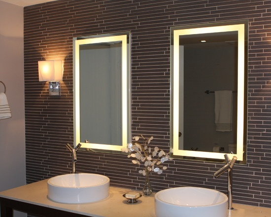 Beautiful tiled wall in the bathroom with individual illuminated mirrors