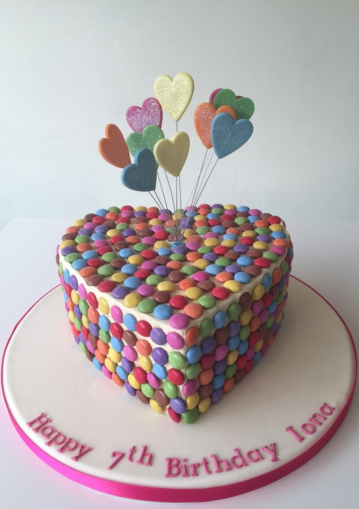 Heart shaped girly birthday cake with smarties and starburst