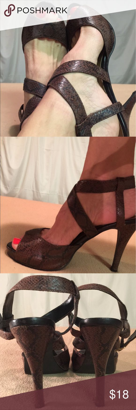 Michael Antonio Brown Snakeskin Ankle Strap Heels These shoes have been Very Gently Worn and are in EXCELLENT CONDITION. The heel height of this shoe is 4.5 inches tall. Michael Antonio Shoes Sandals