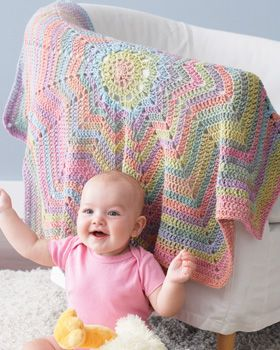 The self striping yarn makes this one a must do one day.  and it would only take 4 balls too!  not all that much to pay to make a baby blanket