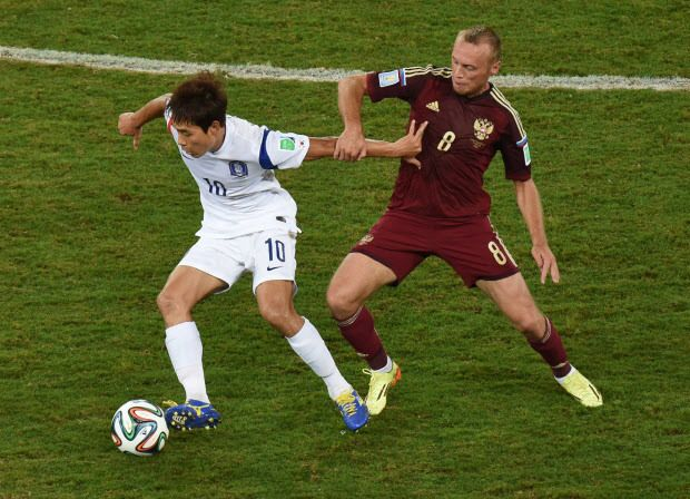 South Korea's forward Park Chu-Young (L) vies with Russia's midfielder Denis Glushakov during a Group H football match between Russia and South Korea in the Pantanal Arena in Cuiaba during the 2014 FIFA World Cup on June 17, 2014.    AFP PHOTO/ PEDRO UGARTEPEDRO UGARTE/AFP/Getty Images