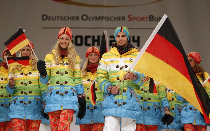 German athletes present the official uniforms of the German Olympic team for the Sochi 2014 Winter Olympic Games in Duesseldorf Oct. 1, 2013...