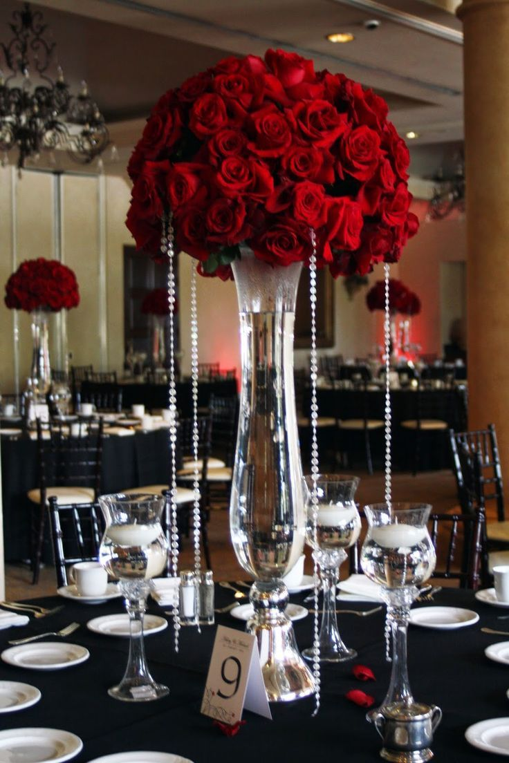 tall red rose wedding centerpieces | Beautiful red rose centerpieces dripping in bling adorned each table.