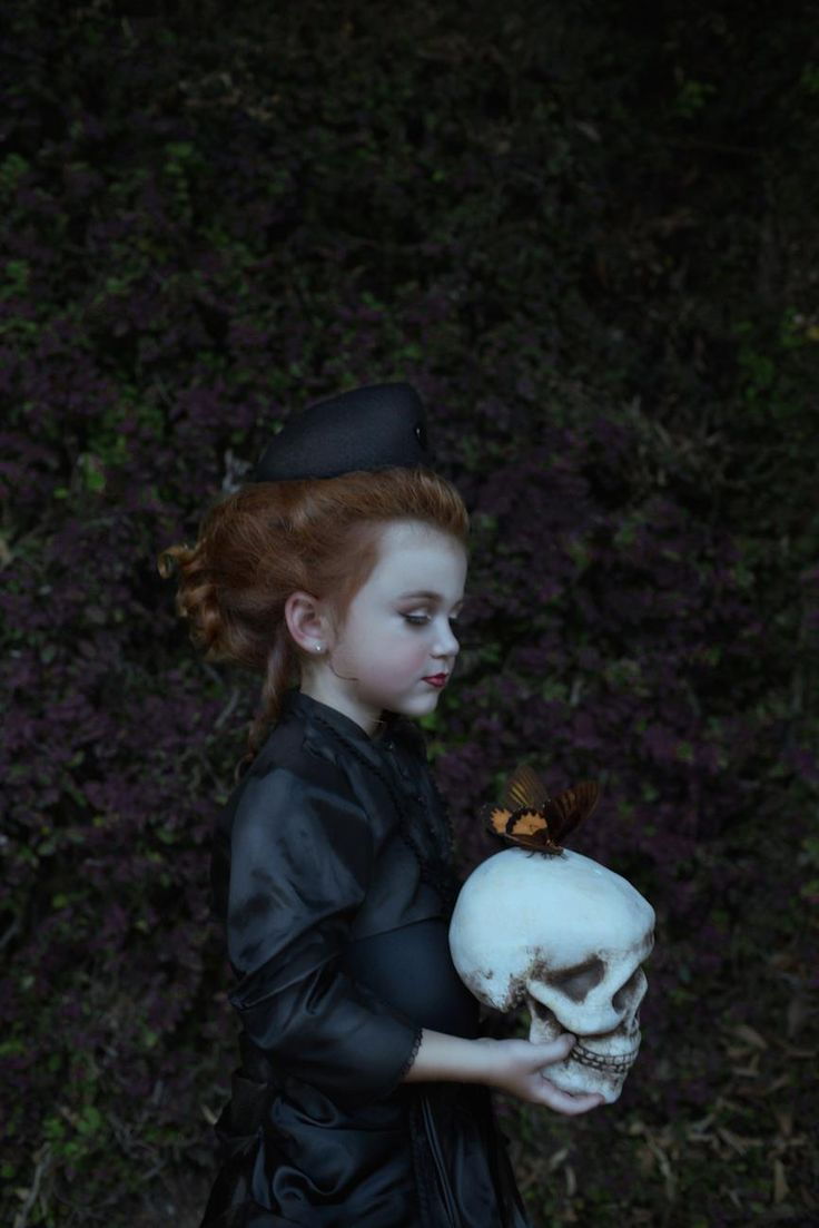 """Photographer Brittany Bentine has been creating macabre photoshoots for children for years now. Other parents have called her work """"sick"""" and """"disturbing,"""" but for Bentine, it's just plain fun."""
