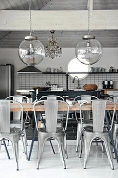 Cool Contrast Between The Wooden Table And The Metal Tolix A Chairs In This Industrial  Dining