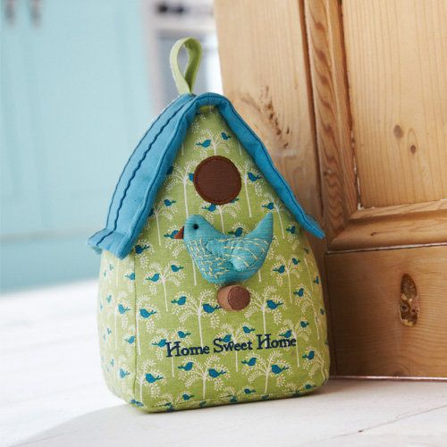 Shaped bird house door stop designed by Ulster Weavers.Our door stops make the perfect gift to make any house a home, in fact they are a great, alternative housewarming gift. The cute characters liven up any room and make a much better addition than a boring old door wedge. With designs and colours to suit a multitude of tastes you will be able to stop doors from banging in style!Cotton with sand & polyester filling. Sponge clean only.Height 22 cm x Base 14 cm