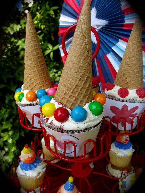 Cute clown cupcakes at a Circus Birthday Party! See more party ideas at CatchMyParty.com!
