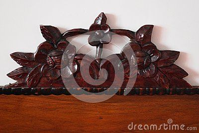Flowers sculpted in wood on a white background