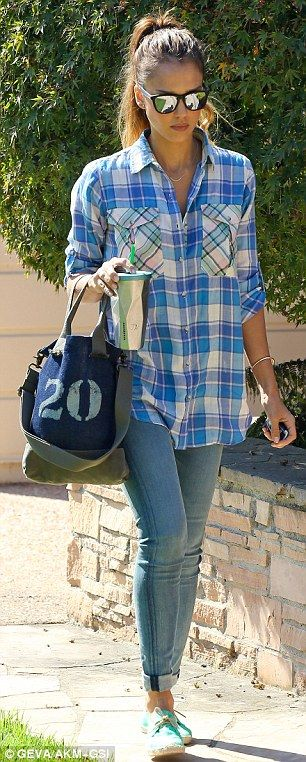 Feeling the blues: The Sin City star sported a blue plaid shirt, skinny jeans, and turquoise sneakers
