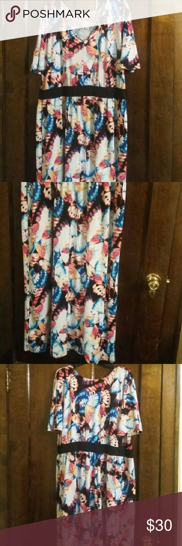 Ashley Stewart dress Ashley Stewart maxi dress with butterfly wings all over it. This dress is in great condition. It's a size 22/24. Ashley Stewart Dresses Maxi