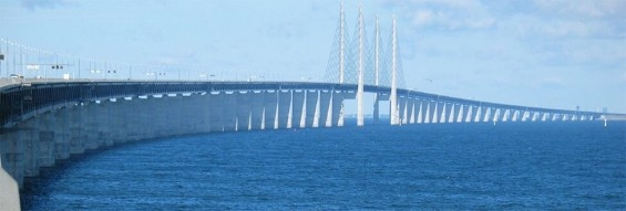 The Oresund Bridge crosses the Oresund strait and joins Sweden with Denmark. It begins as a cable-stayed bridge in Sweden and ends as a tunnel in Denmark. A small artificial island was built around the tunnel's entrance to keep water from creeping in.