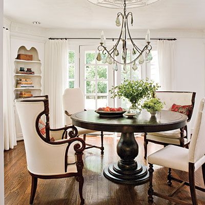 Love the table and mix of chairs. The light fixture is pretty too!