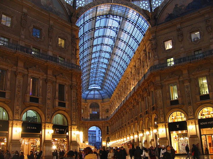 Galleria Vittorio Emanuele II, photo by Alterboy. The Galleria Vittorio Emanuel II is said to be the oldest shopping mall in the world. It was designed and built in the 1800s and features a huge glass and steel arch covering a long street.