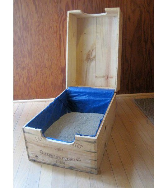 Wine Case Recycling Use #37: Litter Box is a stylish idea, assuming you have wine crates left after making your underbed storage and modular entryway system! One side is hinged for easy scooping access, and lined with plastic to keep the kitty litter from leaking through any cracks in the wood.