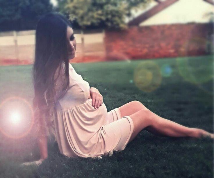Soft and elegant lace sleeve maternity dress.