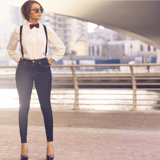 Black Suspenders With Blue Denims, White Shirt, Black Shades, Heels And Also Red Bow Tie.