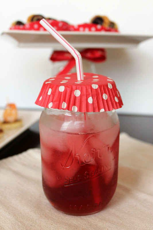 """Serve a specialty drink in your school's color with a matching """"anti-insect"""" cupcake liner lid. 