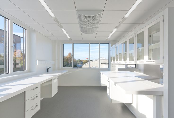Novo Nordisk BRB2 - RH ARKITEKTERThe main idea for BRB2 is to create modern laboratory and office facilities in a light environment. By using glass walls and doors in the hallway, daylight is drawn into the centre of the building and visual contact across the building is made possible.