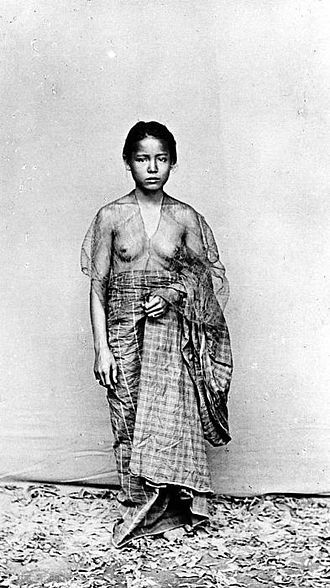 Indonesia, Makassar ~ Young Makassar woman in traditional clothes (baju bodo) in the colonial period, 1930s.