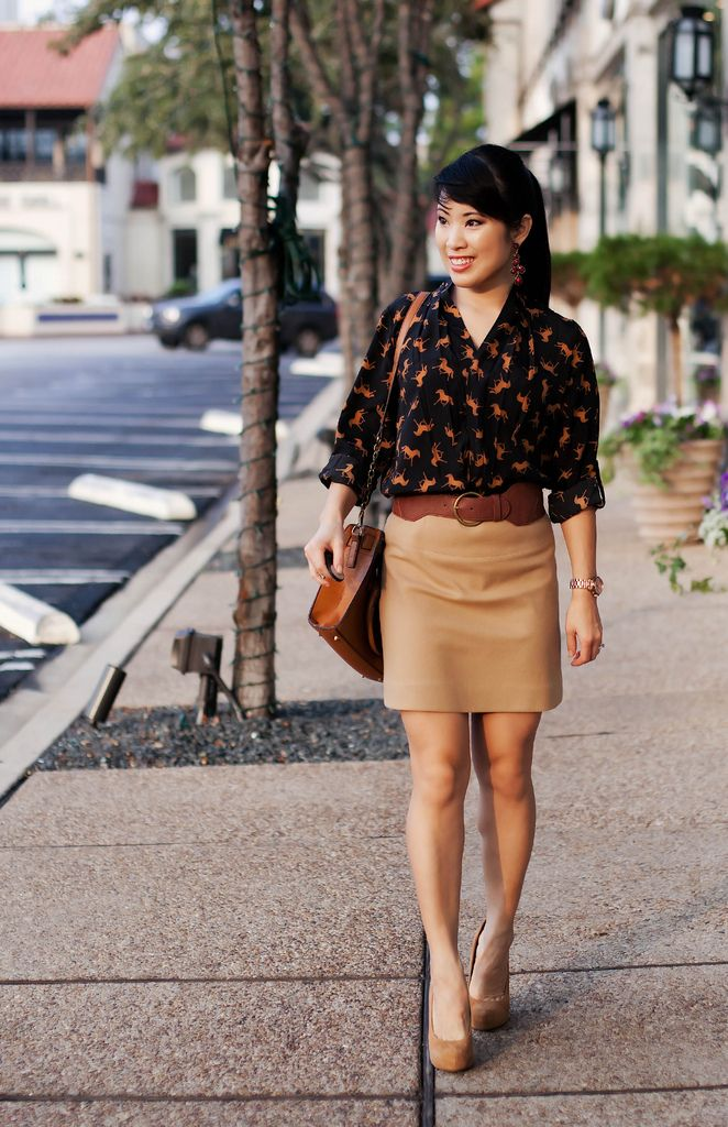 horse print blouse and tan suede skirt with nude pumps