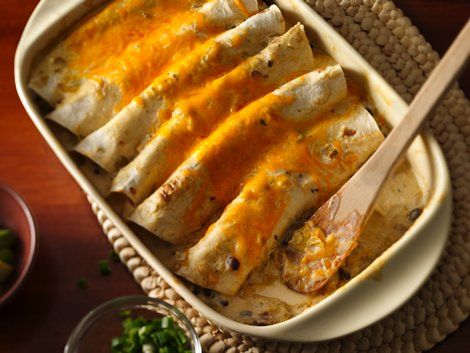 Chicken Enchiladas - The cooking sauce is the secret for making these enchiladas super creamy and full of flavor.