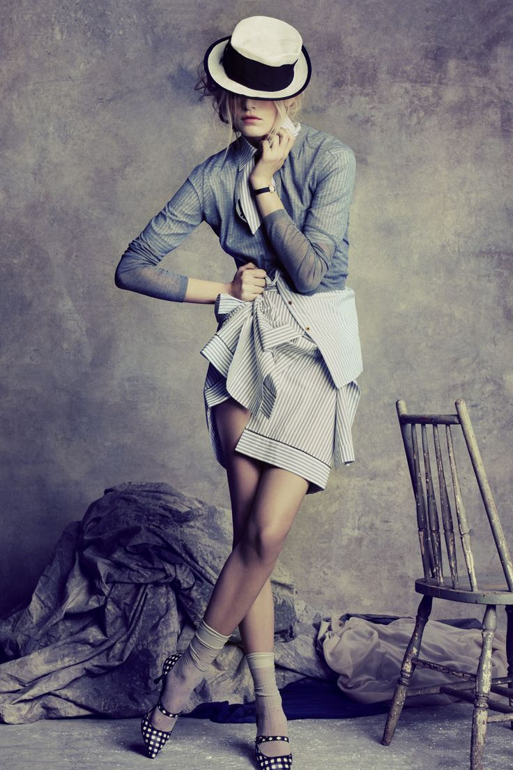 Cardigan, $395, Burberry Brit; shirt, $715, skirt. $600, Fendi; shoes, $695, Marc Jacobs; socks, $8, Hue; hat, $335, Emporio Armani; watch, price upon request, Dior Timepieces.   - MarieClaire.com