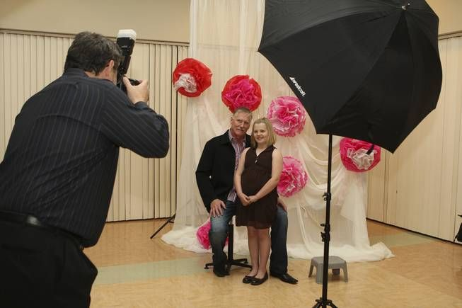 Father-Daughter Dance - Cassidie Paulk, 8, poses for a photograph with her father, ... - Las Vegas Sun News