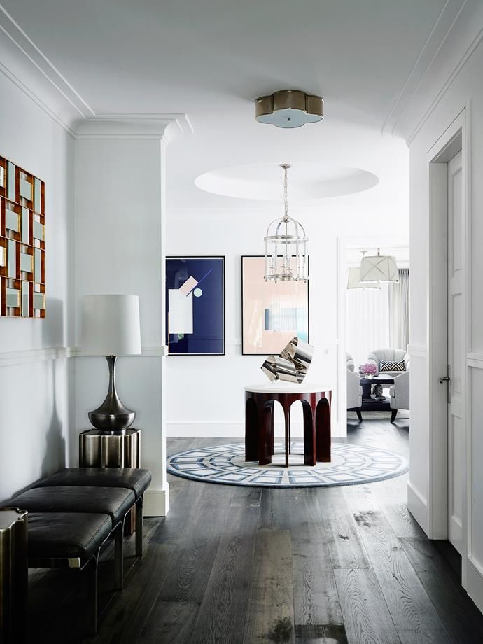 Generous proportions provided the opportunity for wide hallways that feel almost gallery-like with the art purchased from South Africa and elsewhere. Photo: Anson Smart  | Story: Belle